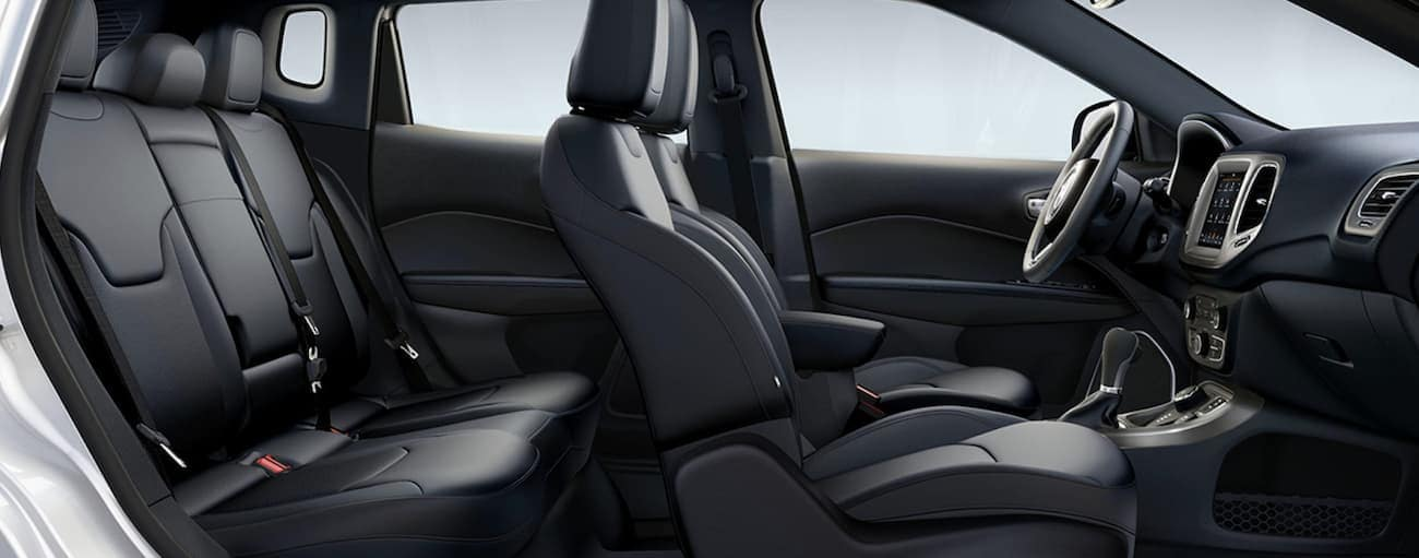 The side view of the black interior of a 2020 Jeep Compass is shown.