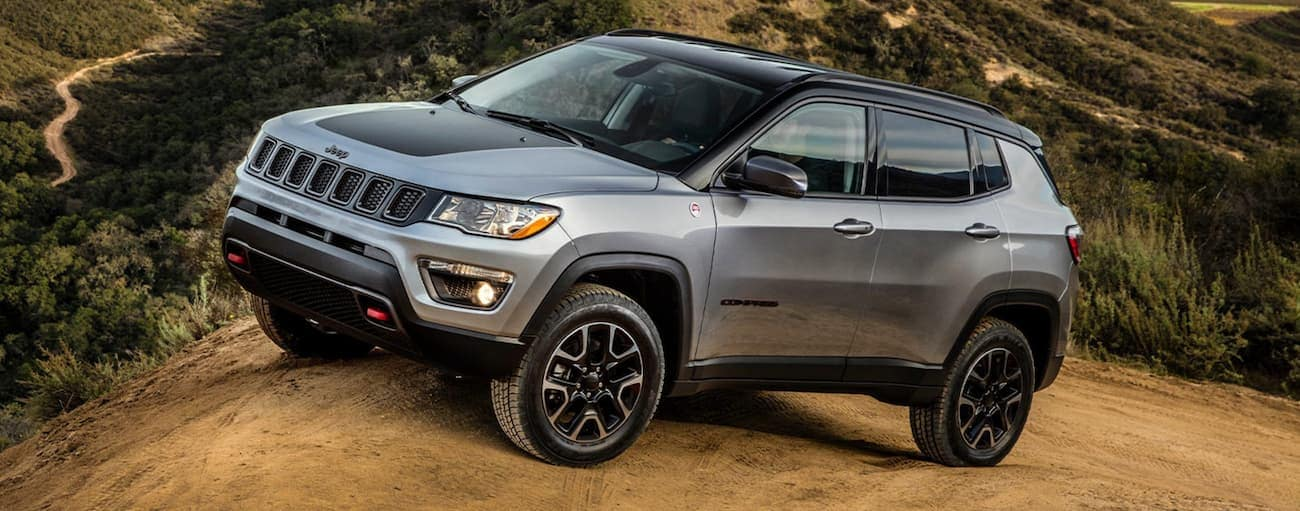 A grey 2020 Jeep Compass Trailhawk is off-roading on dirt near Costa Mesa, CA.