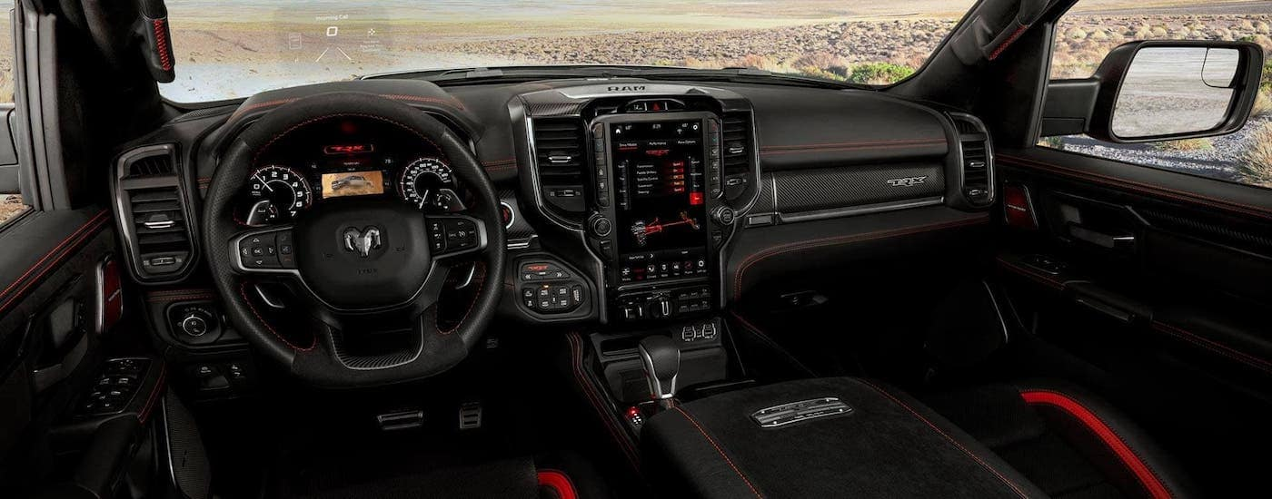 The black and red interior of a 2021 Ram 1500 TRX is shown.