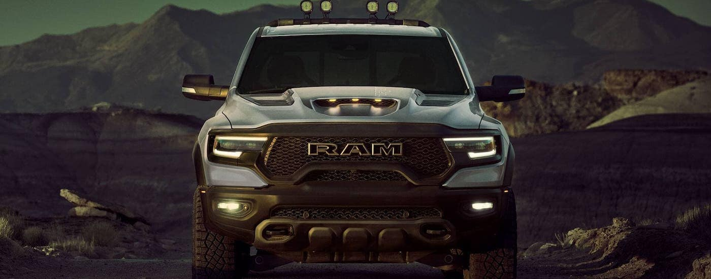 A white 2021 Ram 1500 TRX is shown from the front in a desert.