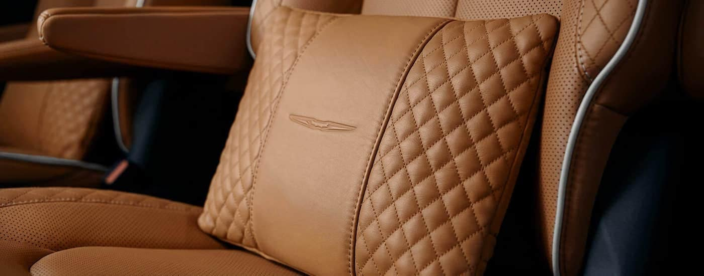 A close up is shown of the brown leather interior of a 2021 Chrysler Pacifica.
