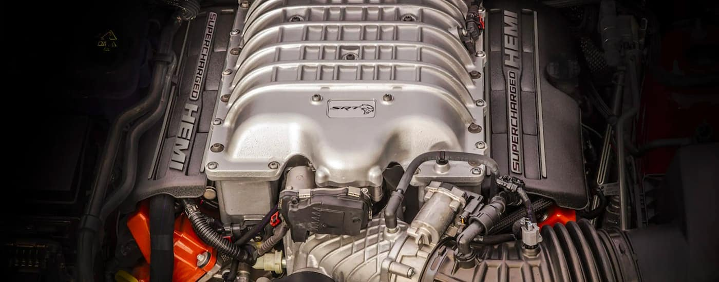 A close up is shown of the supercharged Hemi engine on a 2021 Jeep Grand Cherokee SRT.