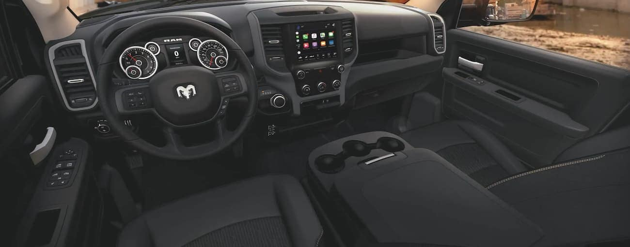 The black interior of a 2021 Ram 2500 is shown.