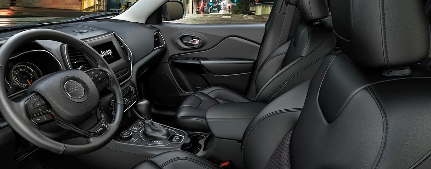 The black interior is shown from the drivers side in a 2021 Jeep Cherokee.