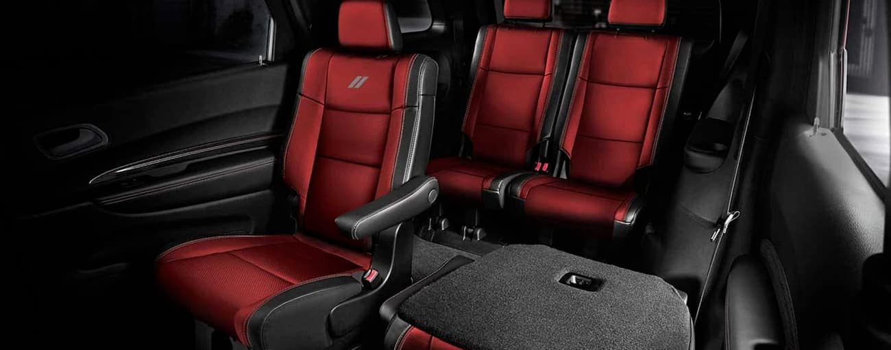 The black and red interior is shown in a 2021 Dodge Durango.
