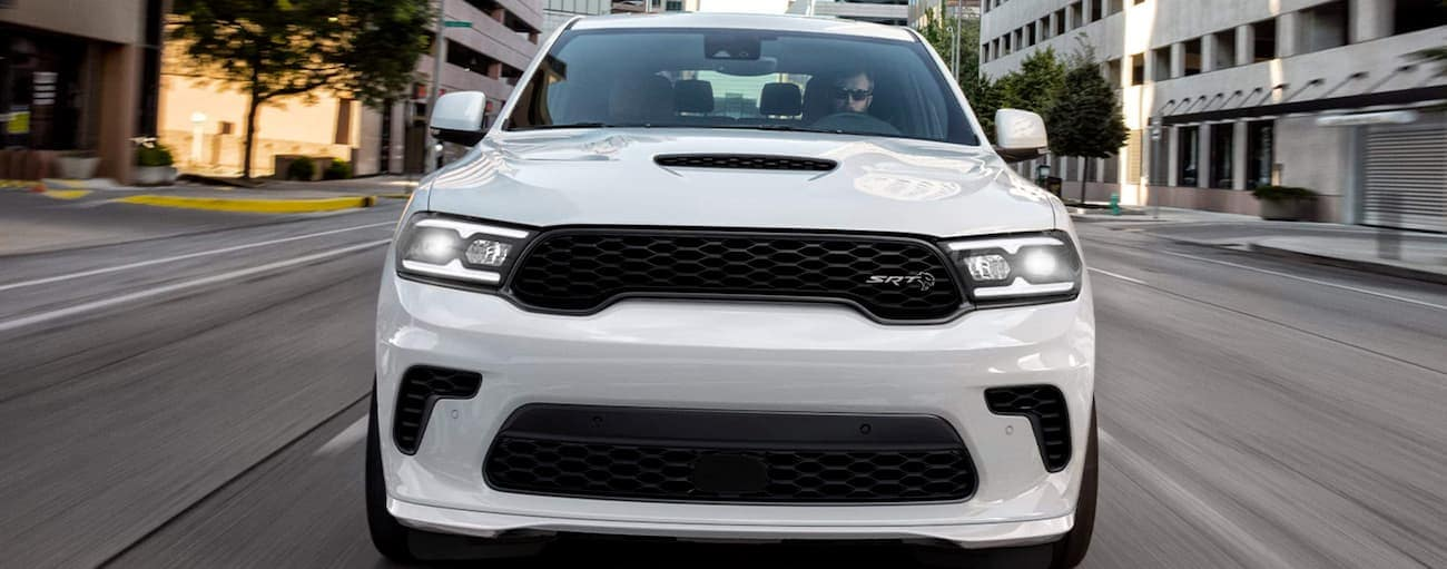 A white 2021 Dodge Durango is shown from the front on a city street.
