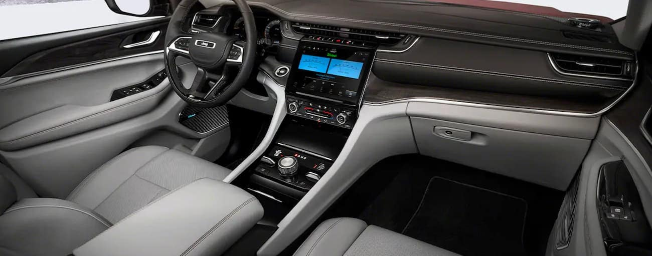 The black and white interior in a 2021 Jeep Grand Cherokee L is shown.
