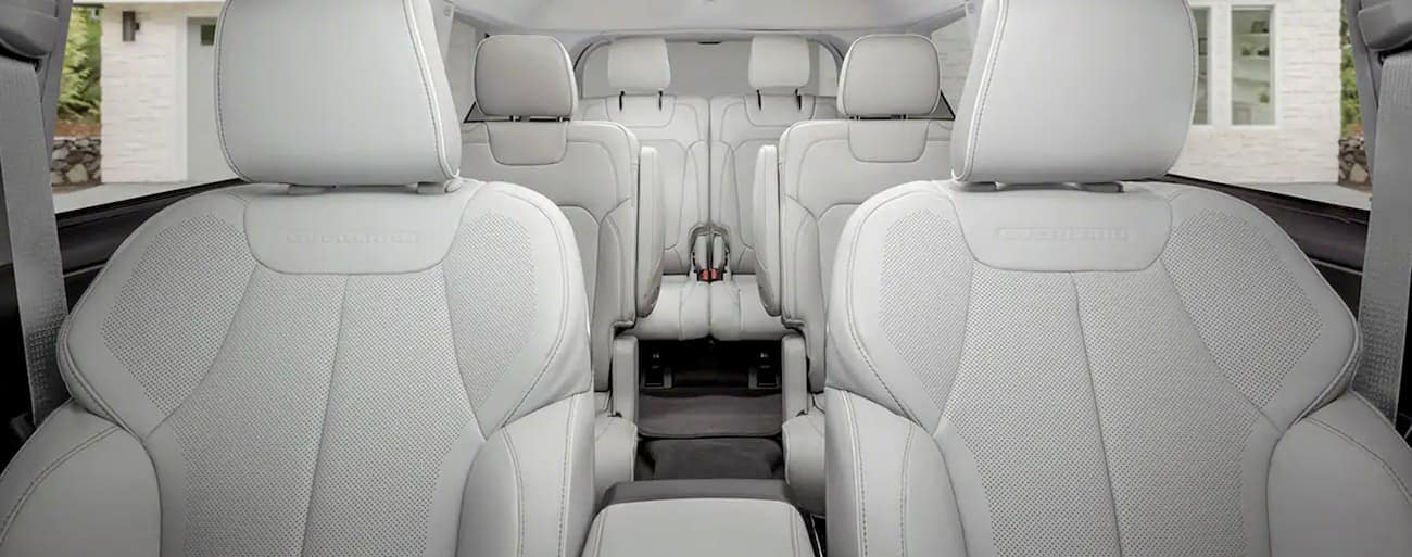 The three-row white seating in a 2021 Jeep Grand Cherokee L is shown.