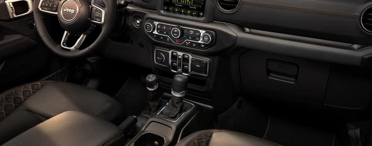 The black interior of a 2021 Jeep Wrangler 4xe is shown.