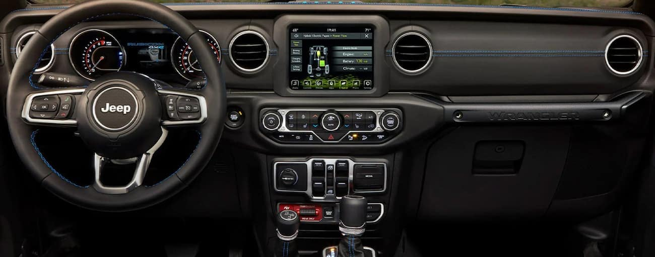The infotainment screen in a 2021 Jeep Wrangler 4xe is shown.