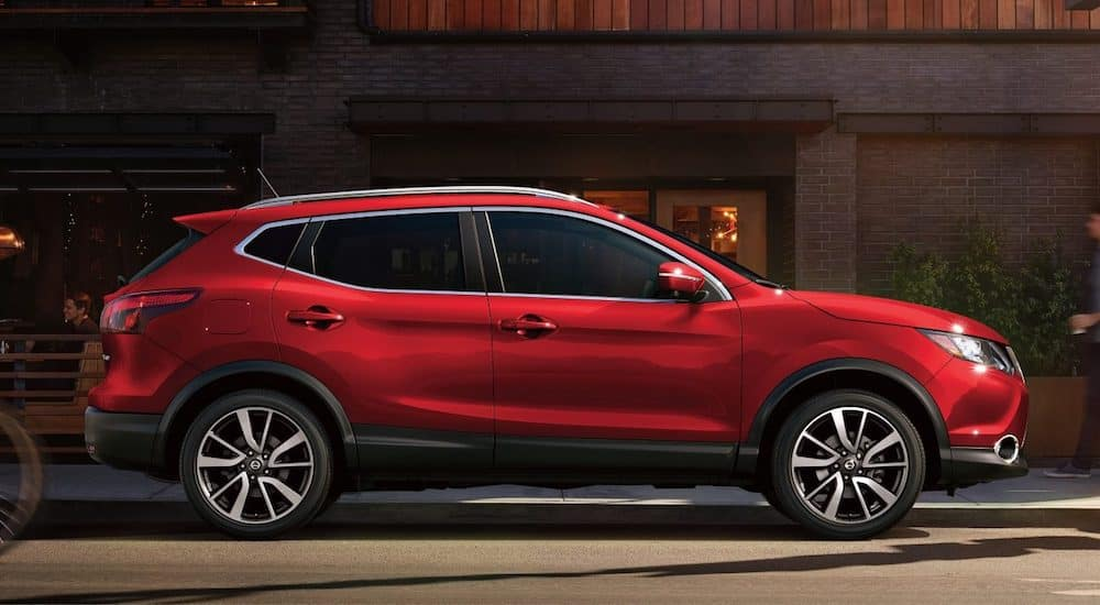 Red 2018 Nissan Rogue Sport parked in front of coffee shop