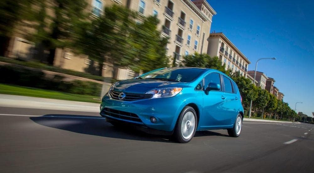A blue 2019 Nissan Versa Note on a test drive from a local Nissan Dealership
