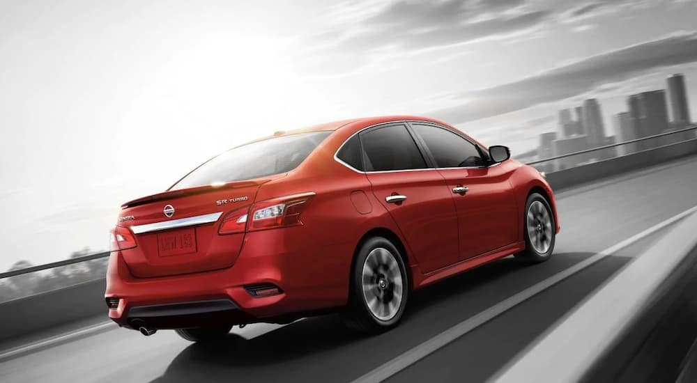 A red 2019 Nissan Sentra on a test drive from a Nissan Dealer in Orange County