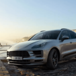 2020 Porsche Macan towing a trailer with jetski on California beach