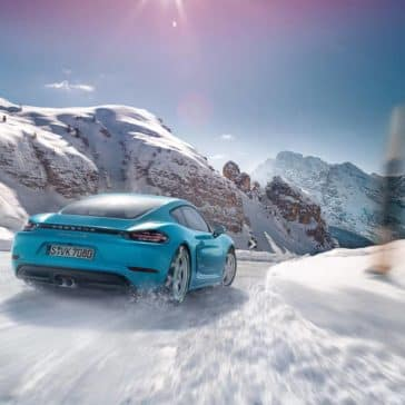2018 Porsche 718 Cayman driving in mountain snow