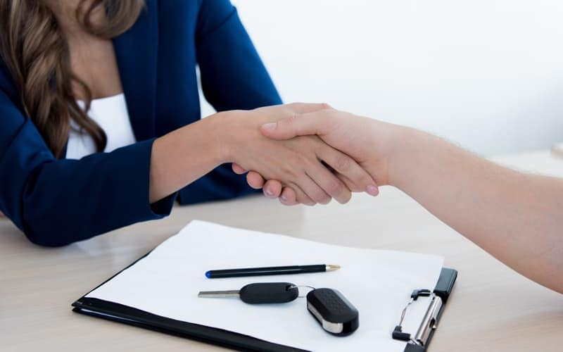 Customer and sales manager shaking hands