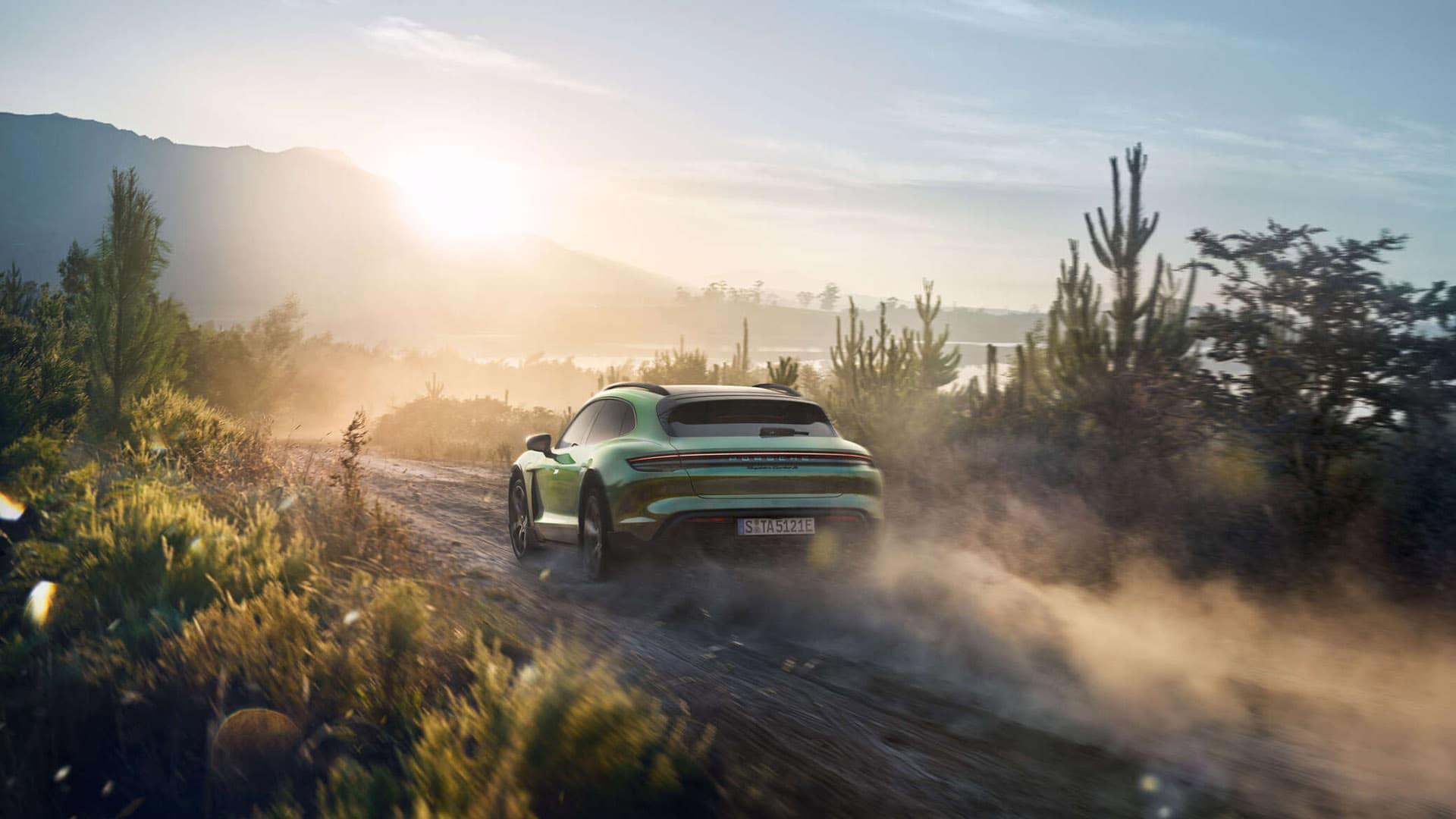 Taycan Turbo S Cross Turismo off road in a desert landscape.