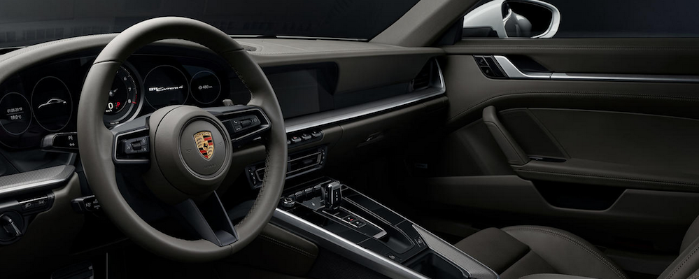 Front seats and dashboard in cabin of Porsche 911 Carrera