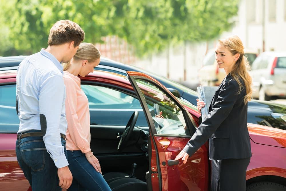 Car salesman and cutomers