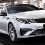 White 2020 Kia Optima on Highway