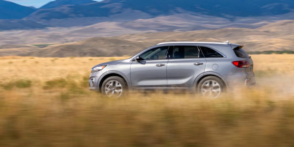 Silver 2020 Kia Sorento Driving Through Field