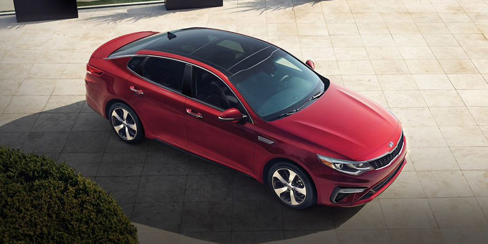 Red 2019 Kia Optima Parked in Driveway