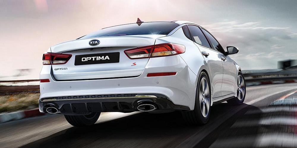 White 2020 Kia Optima Going Around Track