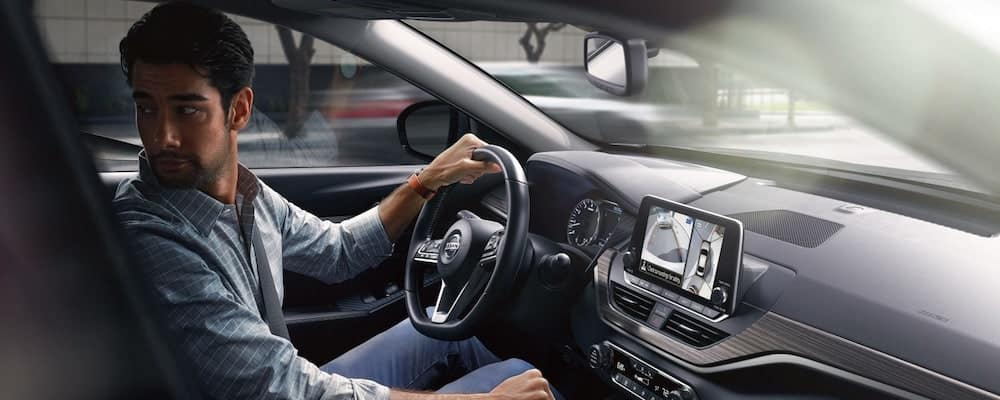 man driving altima
