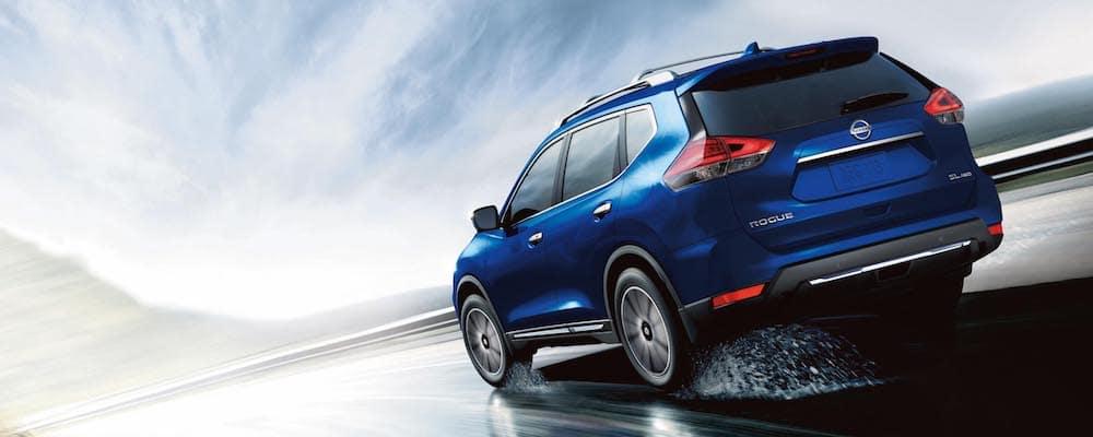 Blue 2020 Nissan Rogue on Rainy Road