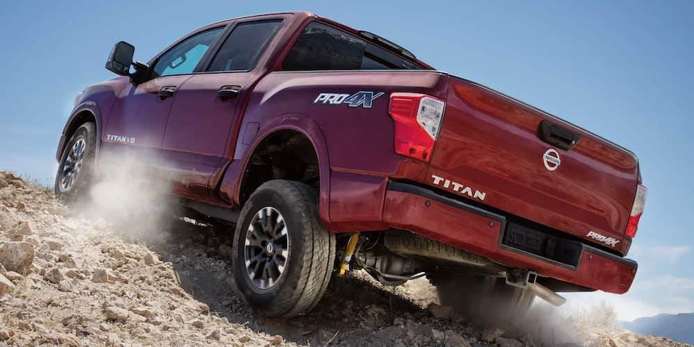Red 2019 Nissan Titan Climbing Rocks