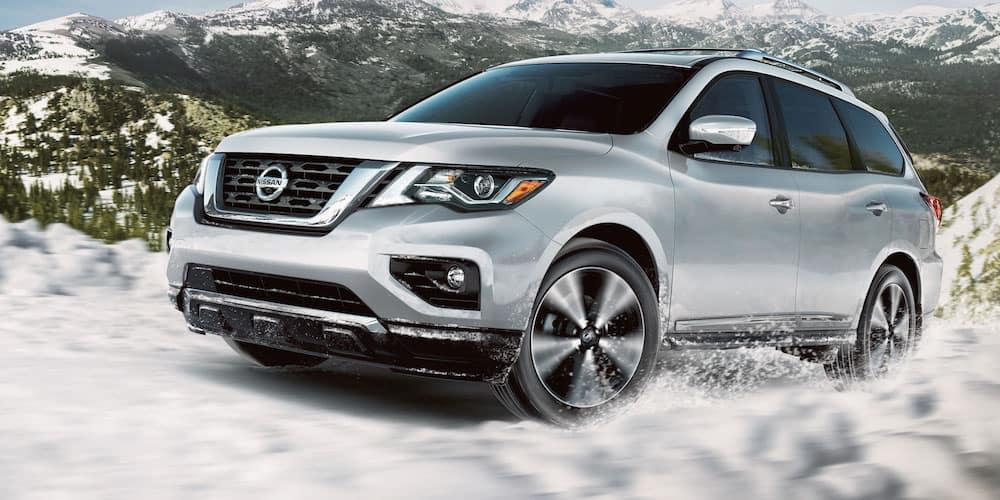 2020 Silver Nissan Pathfinder on Snowy Road