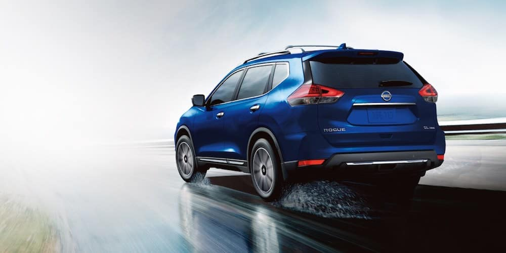 Blue 2020 Nissan Rogue Driving on Rainy Highway