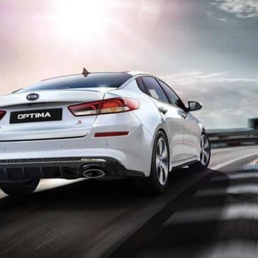 2019-Kia-Optima-rear-driving-white