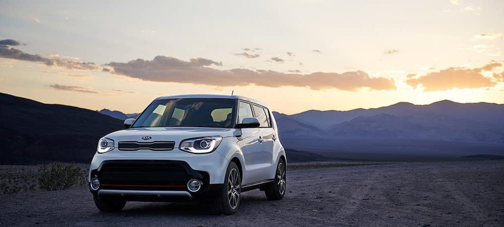 White 2019 Kia Soul parked near mountains at sunset