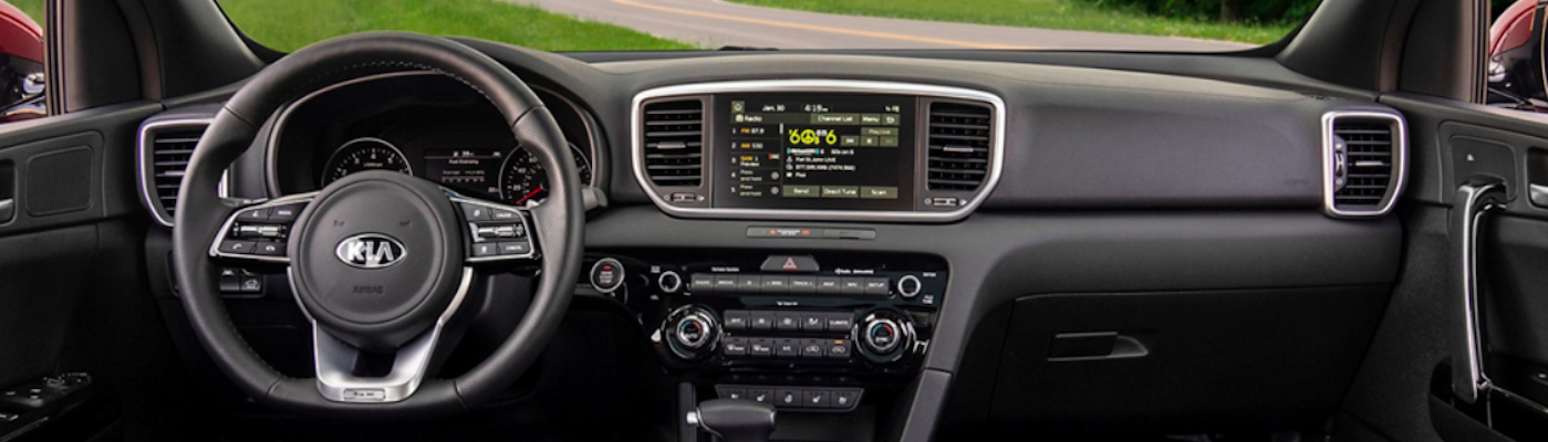 Front-seat view of Kia Sportage dash including UVO interface
