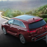 Sorento towing pop-up trailer on mountain highway