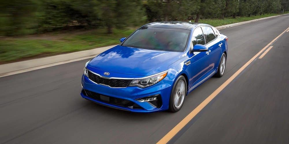 blue 2019 optima driving on highway