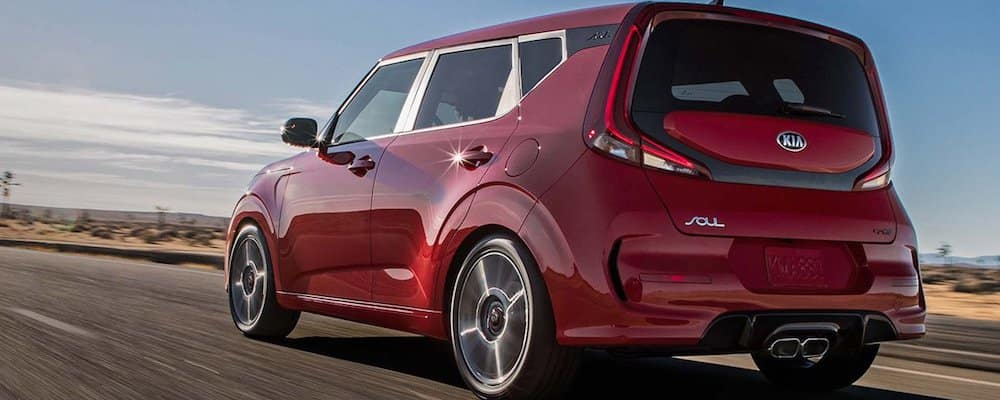 2020 red kia soul driving on highway