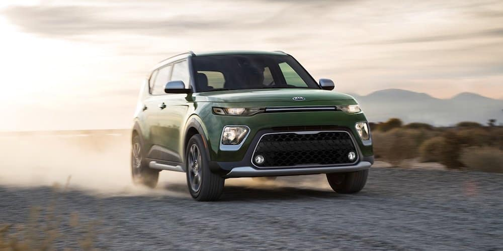 2020 green x-line kia soul on dirt road