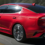 Red 2019 Kia Stinger Driving on Highway