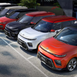 a fleet of Kia SUVs