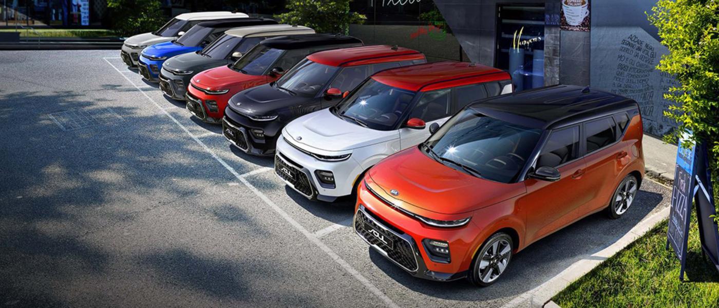 a fleet of Kia SUVs