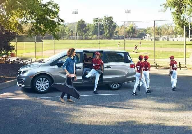 kids step out of 2019 Honda Odyssey in baseball uniforms