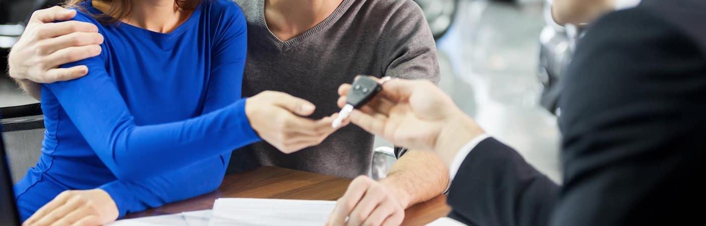 Financer handing keys over to couple
