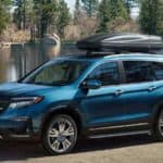 2021 honda pilot blue exterior parked by lake