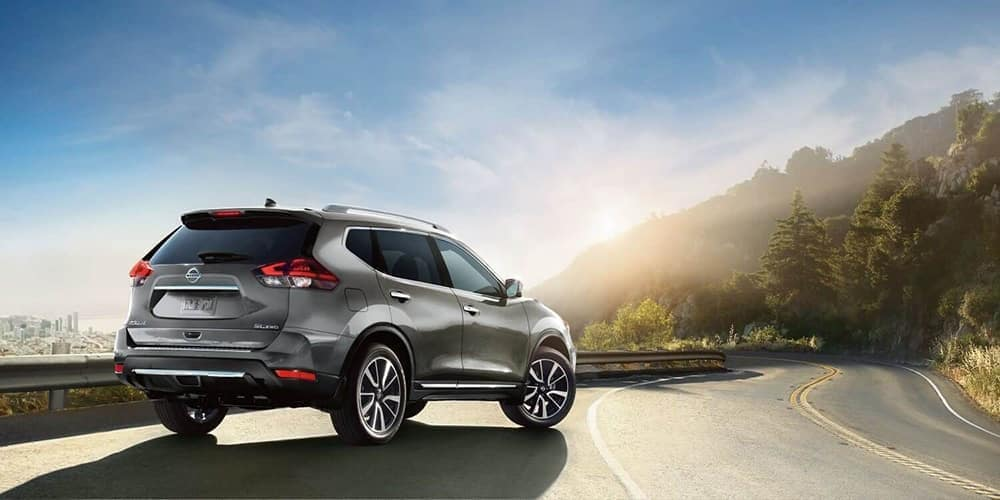 2019 Nissan Rogue Driving Toward Mountain