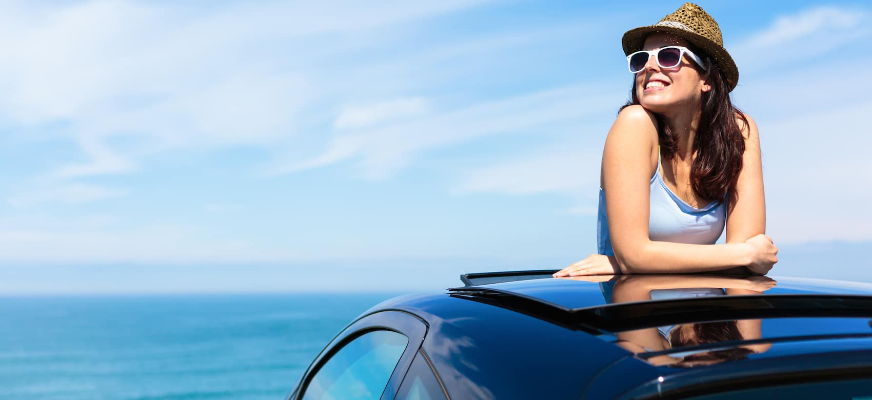 woman coming out of sunroof